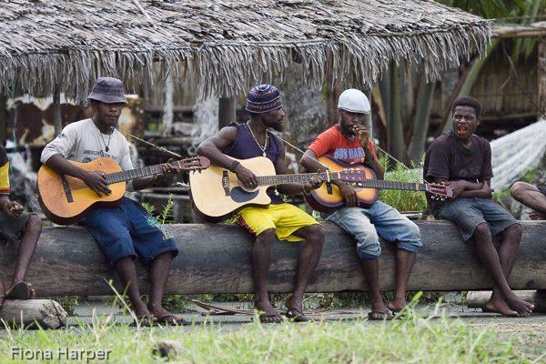 Village boys play guitar at Kopar village, Sepik River, Papua Ne Photo Fiona Harper travel writerw Guinea