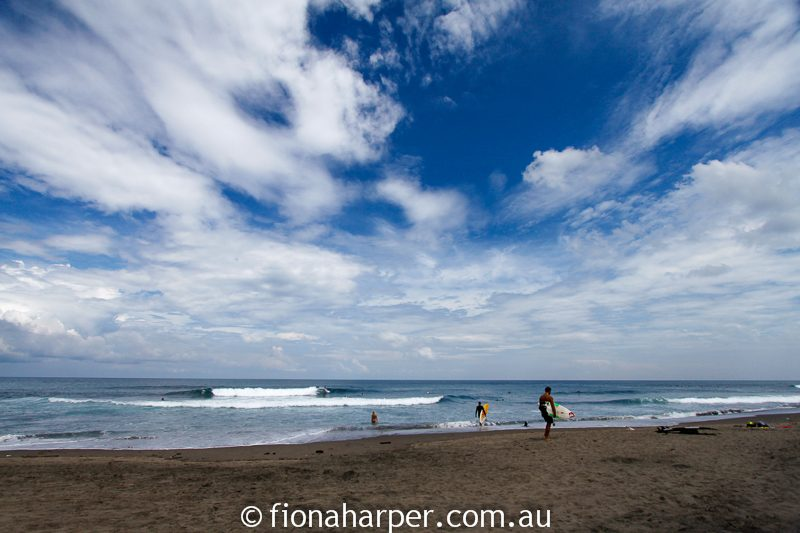 Surfers on beach, Bali, Image by Fiona Harper travel writer